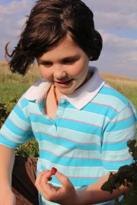 Child enjoys the Project GROW Berry Patch